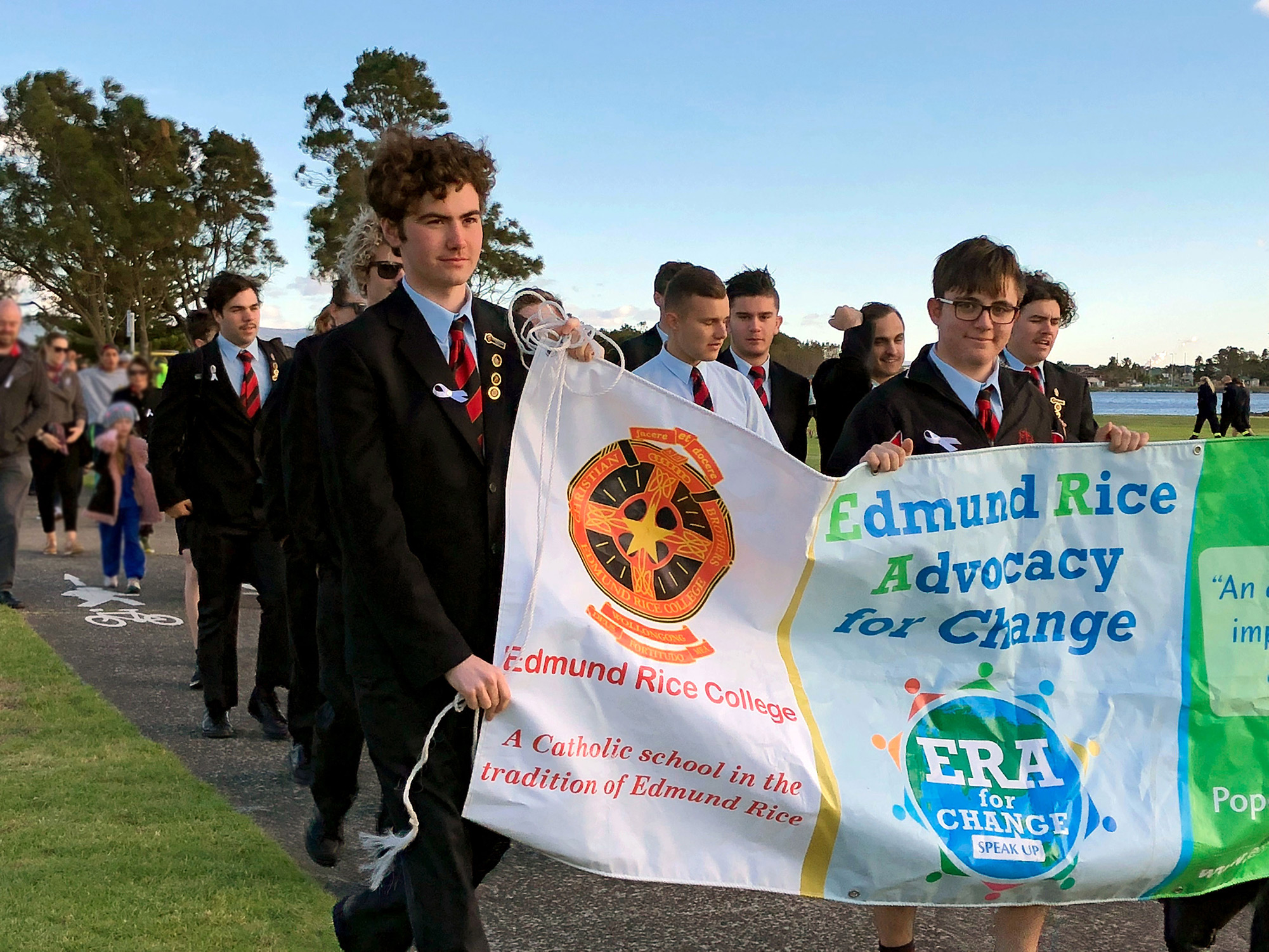 ERC-students-walking-with-sign